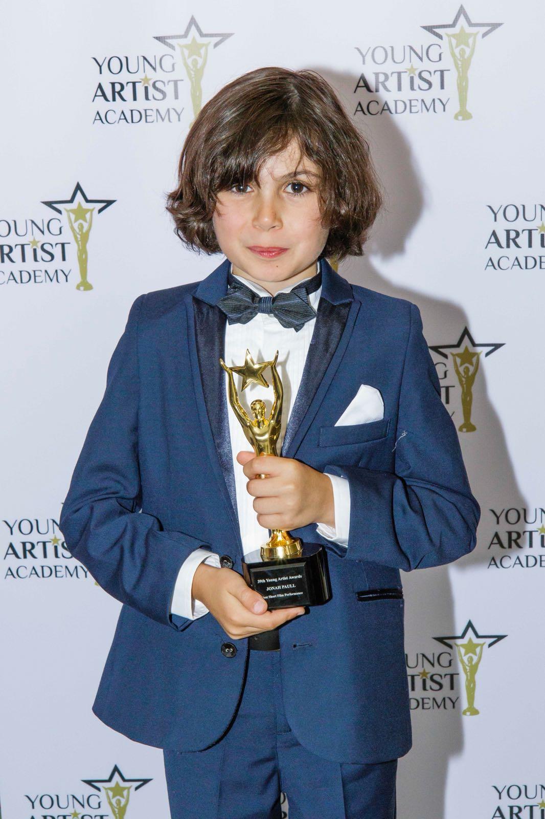 Jonah Paull with the Award
