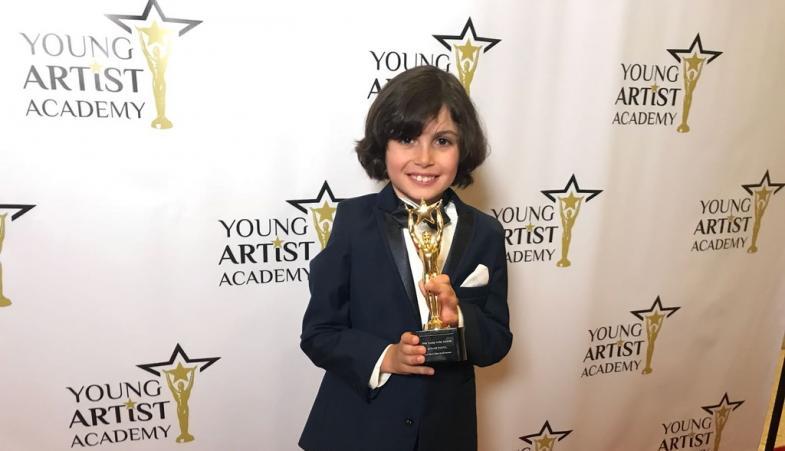 Jonah with the award